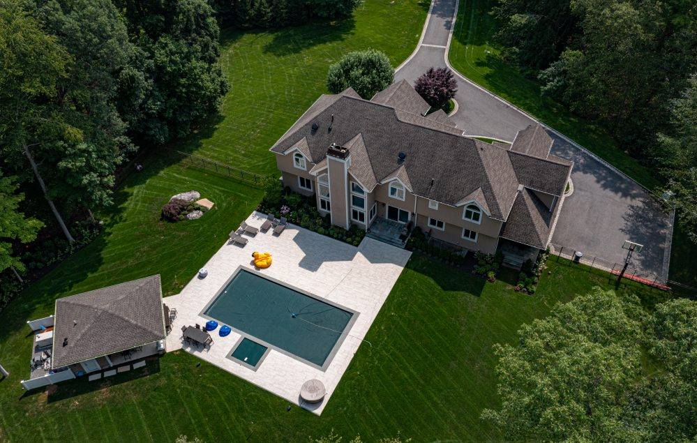 A Jaw Dropping DBI Pool Patio and Pool House and outdoor kitchen